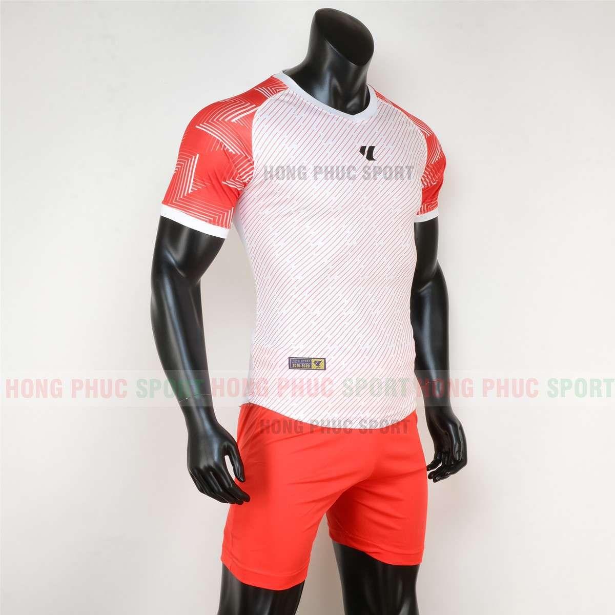 https://cdn.hongphucsport.com/unsafe/cdn.hongphucsport.com/dothethao.net.vn/wp-content/uploads/2020/02/ao-bong-da-khong-logo-lidas-wariors-trang-cam-2.jpg