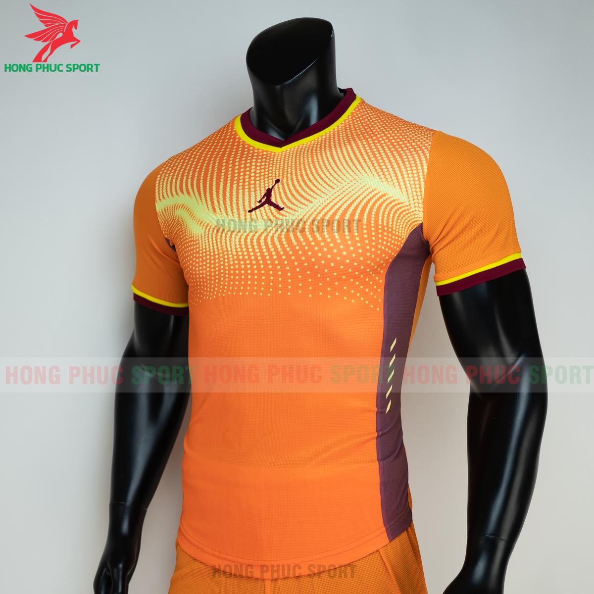 https://cdn.hongphucsport.com/unsafe/s4.shopbay.vn/files/285/ao-bong-chuyen-khong-logo-jordan-wave-mau-cam-2-2-60501f32e81da.png