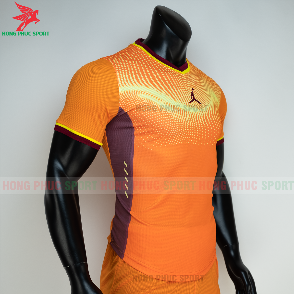 https://cdn.hongphucsport.com/unsafe/s4.shopbay.vn/files/285/ao-bong-chuyen-khong-logo-jordan-wave-mau-cam-5-60501f343fbe7.png