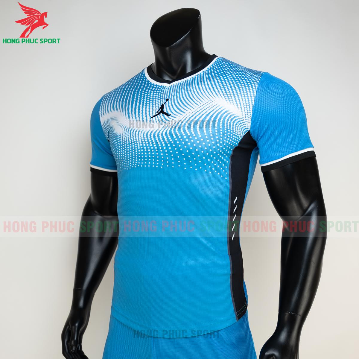 https://cdn.hongphucsport.com/unsafe/s4.shopbay.vn/files/285/ao-bong-chuyen-khong-logo-jordan-wave-mau-xanh-da-1-6050205b5c7d4.png
