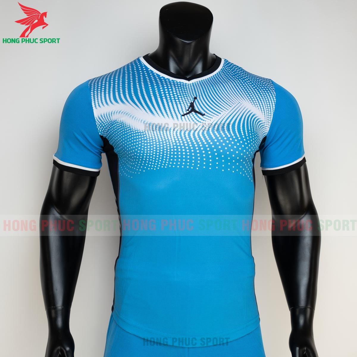 https://cdn.hongphucsport.com/unsafe/s4.shopbay.vn/files/285/ao-bong-chuyen-khong-logo-jordan-wave-mau-xanh-da-2-6050205c9c08d.png