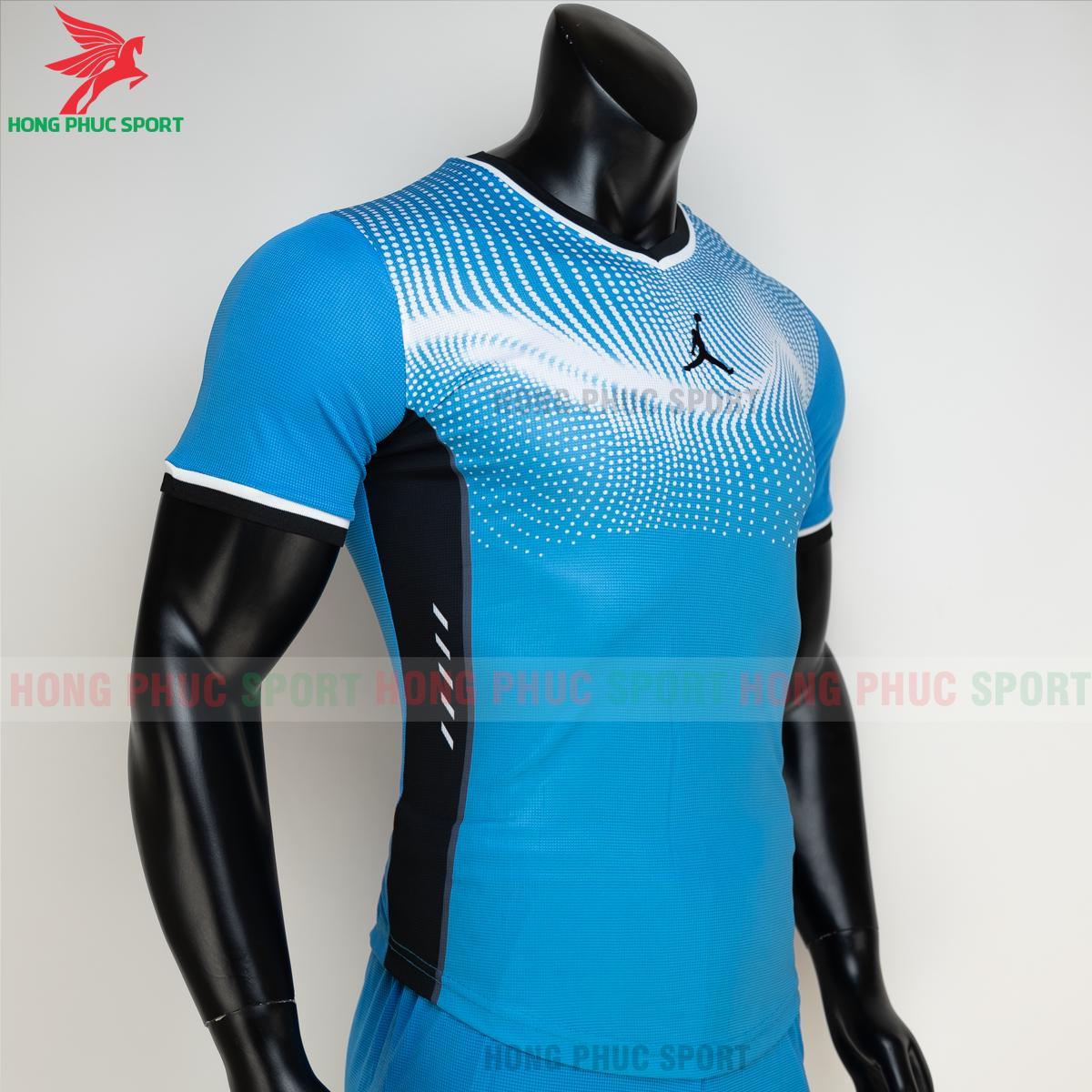 https://cdn.hongphucsport.com/unsafe/s4.shopbay.vn/files/285/ao-bong-chuyen-khong-logo-jordan-wave-mau-xanh-da-7-6050206455f5a.png