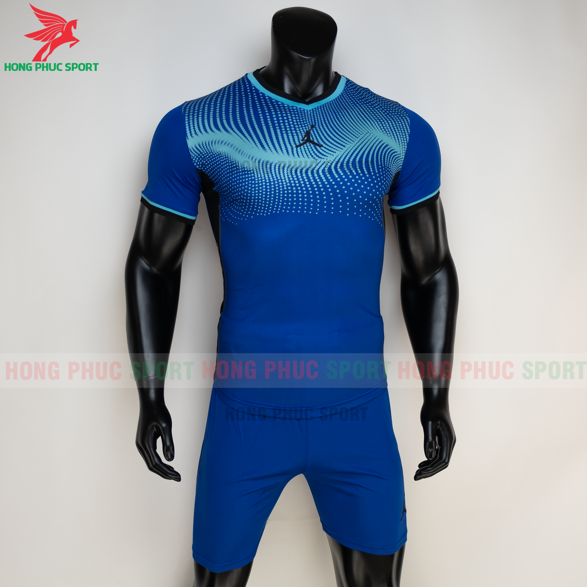 https://cdn.hongphucsport.com/unsafe/s4.shopbay.vn/files/285/ao-bong-chuyen-khong-logo-jordan-wave-mau-xanh-duong-3-605021c0d106d.png