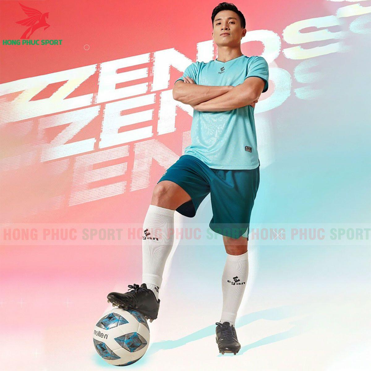 https://cdn.hongphucsport.com/unsafe/s4.shopbay.vn/files/285/ao-bong-da-khong-logo-egan-2021-zenos-xanh-ngoc-60f5436e7bd8d.jpg