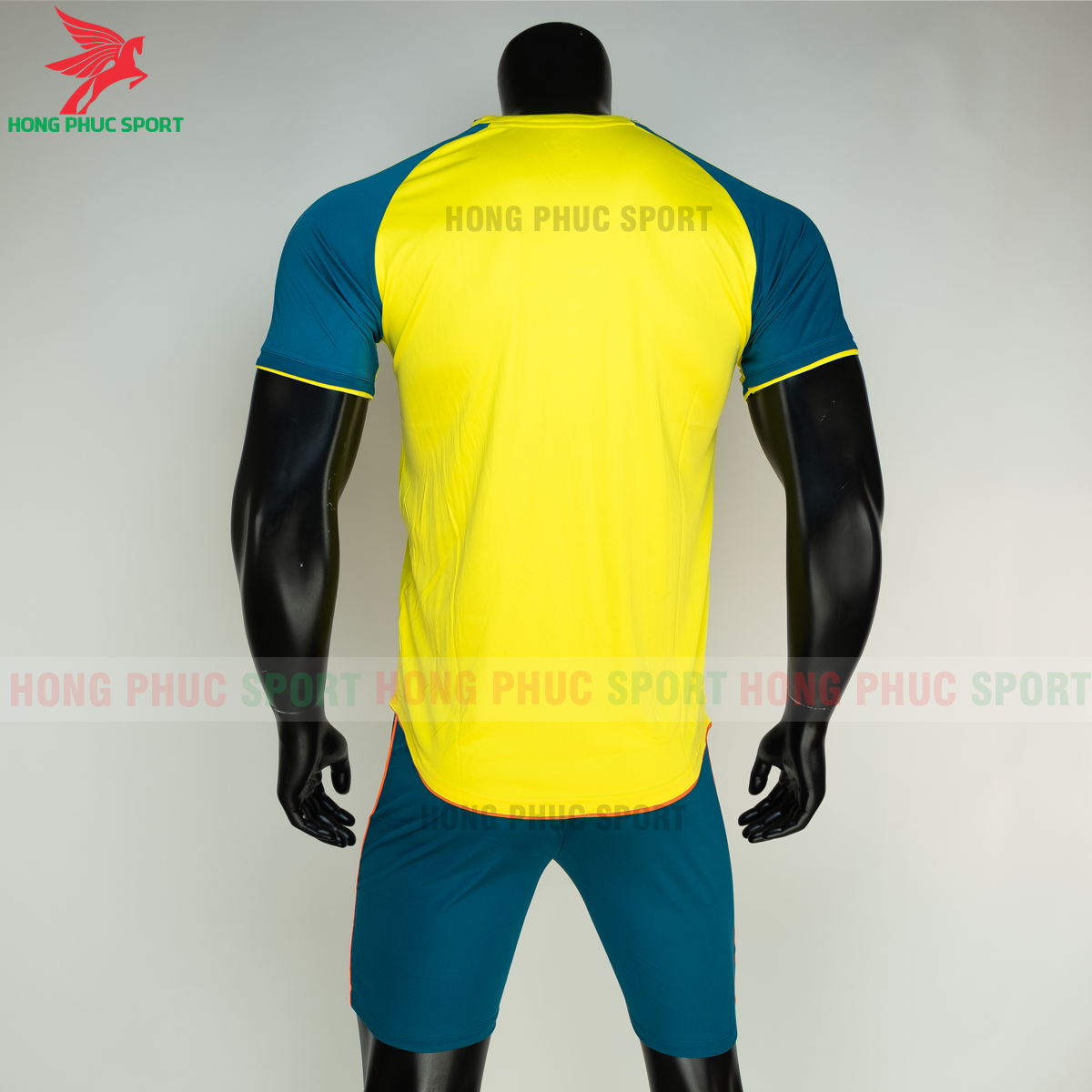 https://cdn.hongphucsport.com/unsafe/s4.shopbay.vn/files/285/ao-bong-da-khong-logo-riki-grambor-mau-vang-8-605061676c7c2.png