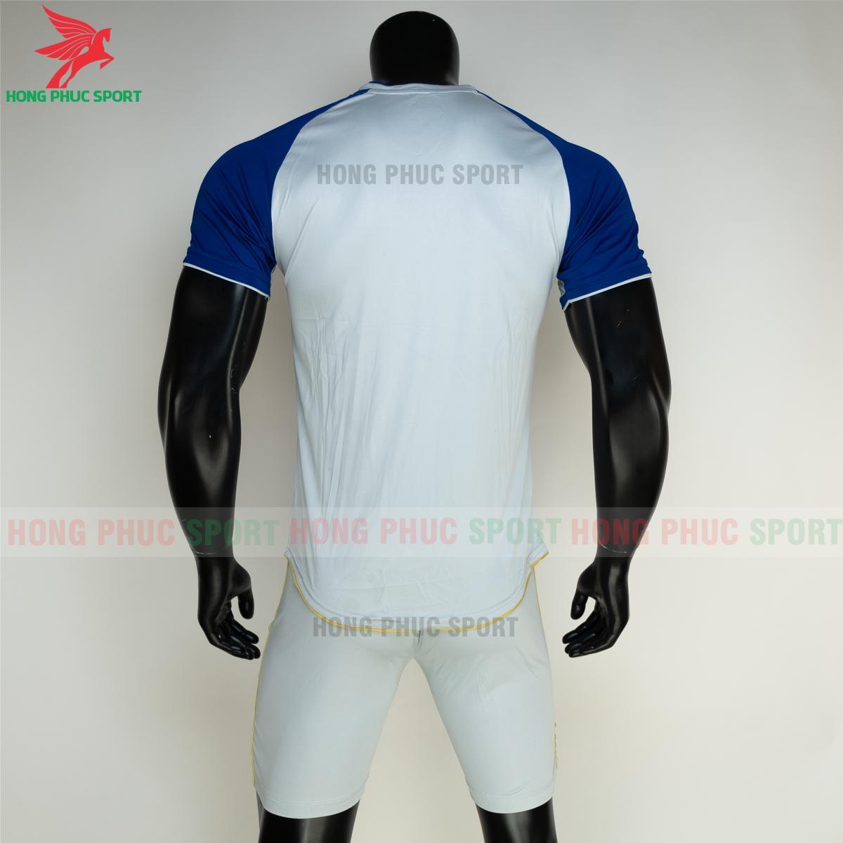 https://cdn.hongphucsport.com/unsafe/s4.shopbay.vn/files/285/ao-bong-da-khong-logo-riki-grambor-mau-xanh-duong-8-605061416f511.png