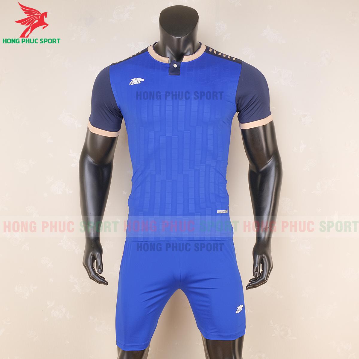 https://cdn.hongphucsport.com/unsafe/s4.shopbay.vn/files/285/ao-bong-da-khong-logo-riki-neck-xanh-duong-6-5f71afc83a449.png