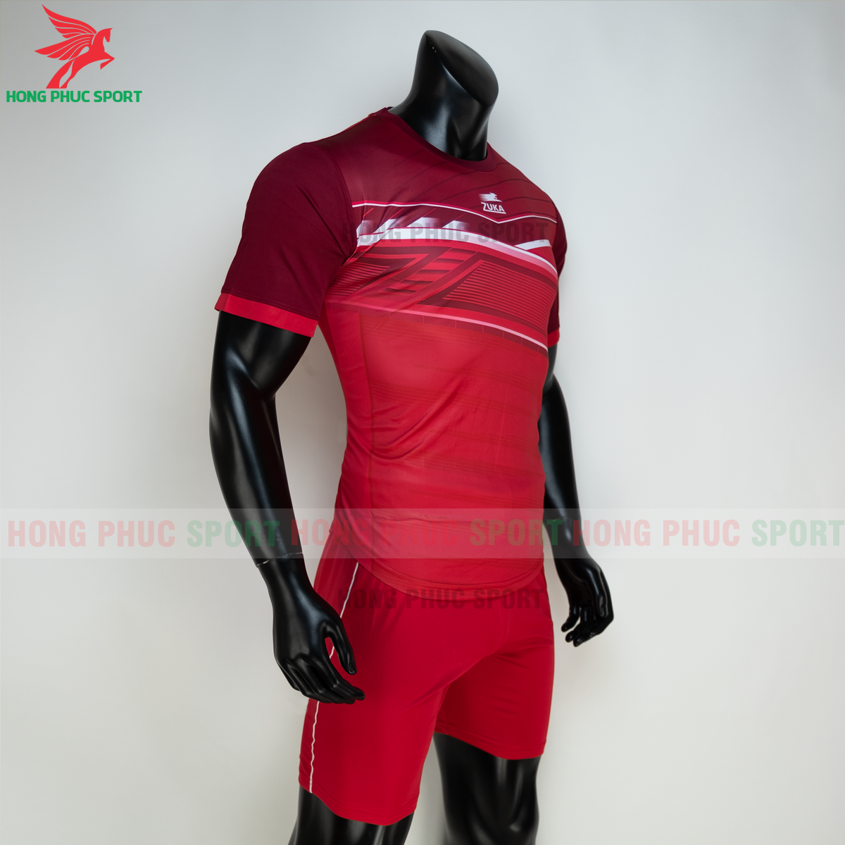 https://cdn.hongphucsport.com/unsafe/s4.shopbay.vn/files/285/ao-bong-da-khong-logo-zuka-01-mau-do-6-60502d516963b.png