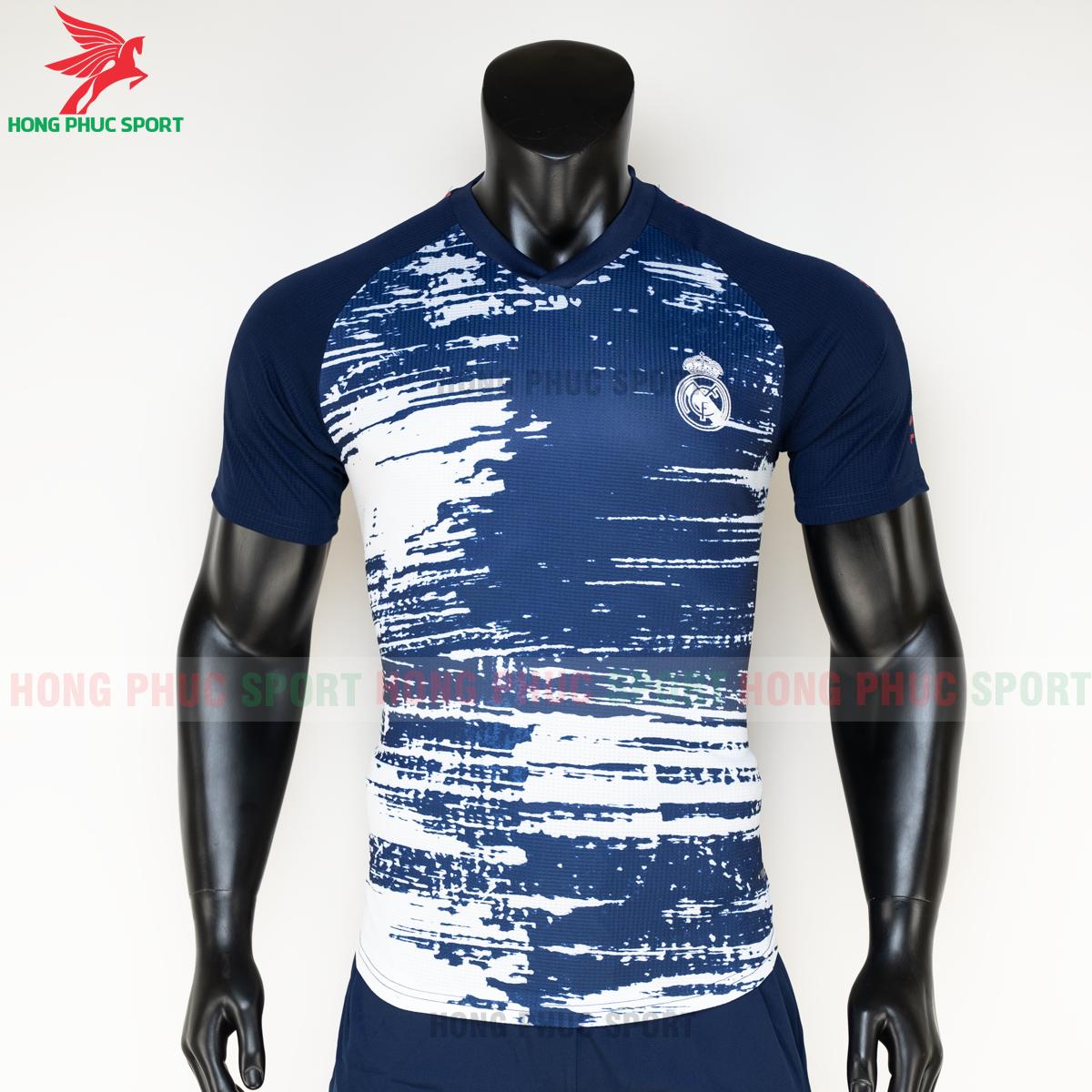 https://cdn.hongphucsport.com/unsafe/s4.shopbay.vn/files/285/ao-bong-da-real-madrid-20-21-pre-match-hang-thailand-1-5faf55e2b9603.png