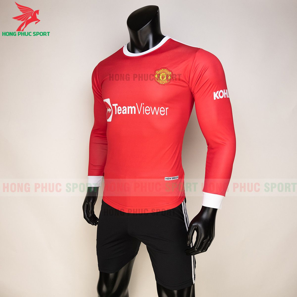 https://cdn.hongphucsport.com/unsafe/s4.shopbay.vn/files/285/ao-bong-da-tay-dai-man-utd-2021-22-san-nha-thun-lanh-4-61557fd1b4a5c.jpg
