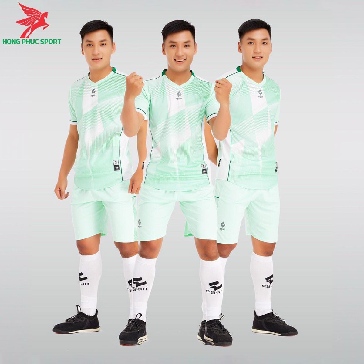 https://cdn.hongphucsport.com/unsafe/s4.shopbay.vn/files/285/ao-da-bong-khong-logo-egan-victory-mau-xanh-ngoc-6050852d4403f.jpg
