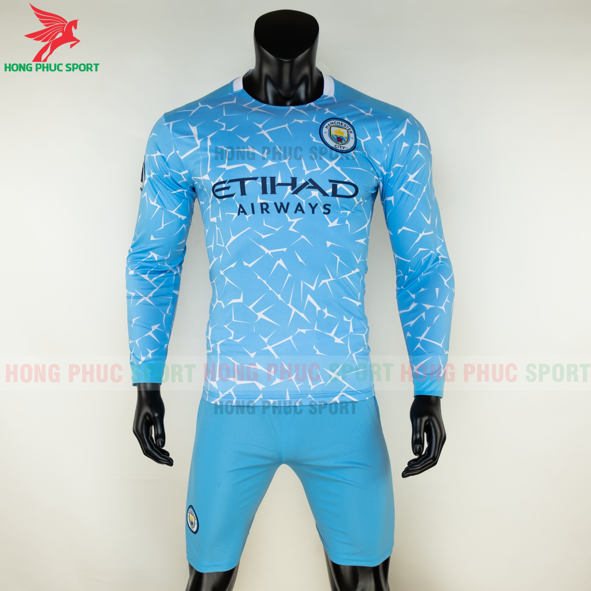 https://cdn.hongphucsport.com/unsafe/s4.shopbay.vn/files/285/ao-dai-tay-manchester-city-2020-san-nha-2-5f8fdbde16dea.png